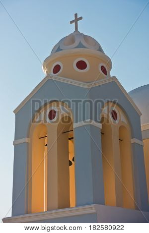 Bell tower of a church at sunset, Imerovigli village, Santorini island, Greece