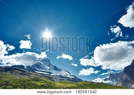 Snow capped mountains and blue sky. Beautiful mountain landscape with views of the Matterhorn peak in Pennine alps, Switzerland.