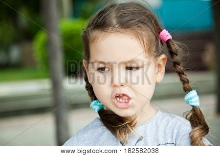 Portrait of sad asian girl with pigtails