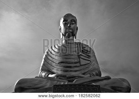 Sculpture of a monk in Thailand. Black and white photography