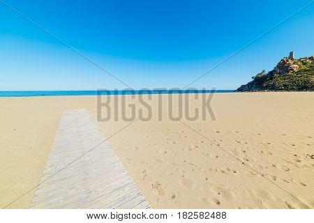 Boardwalk in San Giovanni beach in Sardinia