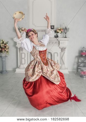 Beautiful Woman In Medieval Dress With Tambourine Dancing