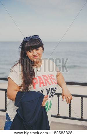 Portrait Of Happy Smiling Beautiful Overweight Young Woman In White T-shirt And Dark Blue Jacket Out
