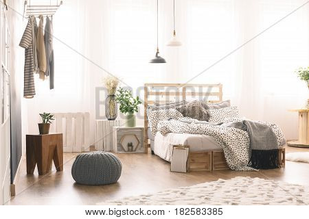 Cozy bedroom with modern wooden furniture and kingsize bed