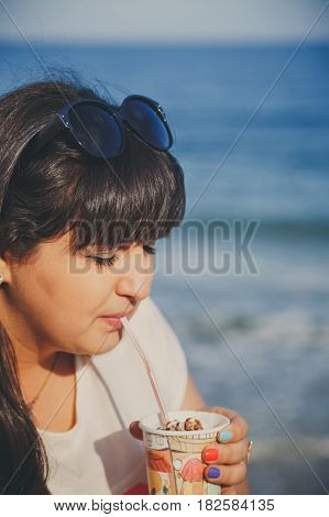 Portrait Of Happy Smiling Beautiful Overweight Young Woman In White T-shirt Drinking Sweet Coffee Th