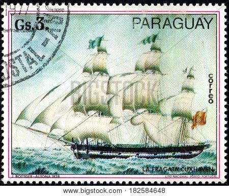 UKRAINE - CIRCA 2017: A postage stamp printed in Paraguay shows sailing ship frigate cuxhaven from the series Paintings German ships circa 1977