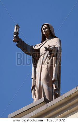 SHKODER, ALBANIA - SEPTEMBER 30: Saint Clare of Assisi statue on St Stephen's Cathedral in Shkoder, Albania on September 30, 2016.