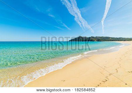 Golden shore in Cala Sinzias in Sardinia