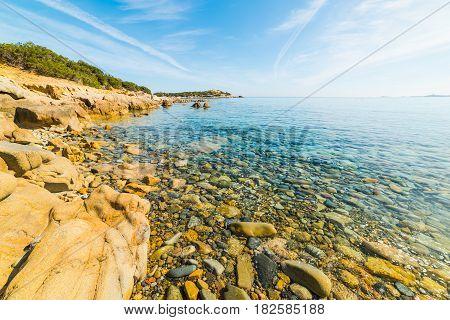 Pebbles in Punta Molentis shoreline in Sardinia