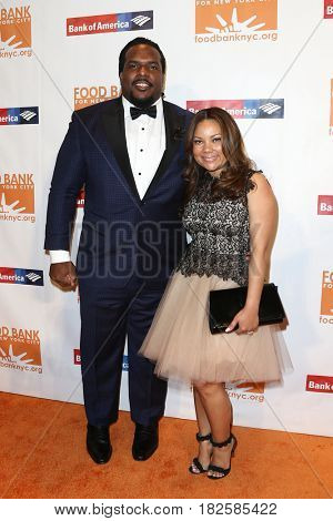 NEW YORK-APR 19: Former NFL player Willie Colon (L) and Aikisha Holly attend the Food Bank for New York City's Can-Do Awards Dinner 2017 at Cipriani's on April 19, 2017 in New York City.