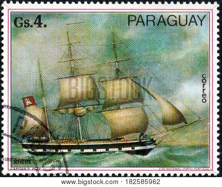UKRAINE - CIRCA 2017: A postage stamp printed in Paraguay shows sailing ship Rhein from the series Paintings German ships circa 1977