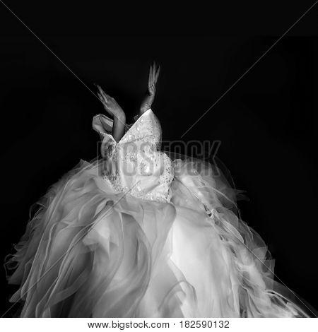Bride looks like a bird putting a wedding dress