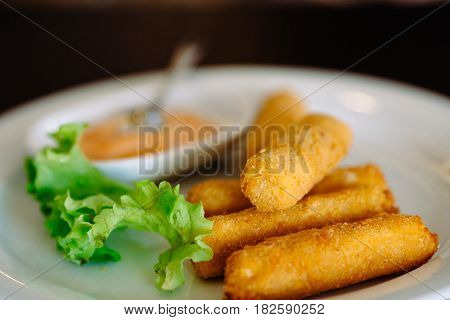 fried mozzarella cheese sticks breaded selective focus