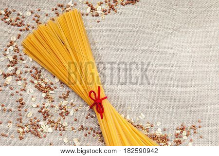 Background Wallpaper, Pasta Spaghetti, Croup, Buckwheat, Rice, Oatmeal, Cereal, Scattered On Fabric.