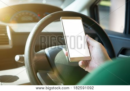 Man driver using smart phone in car during traffic jam blank white screen for design purpose .
