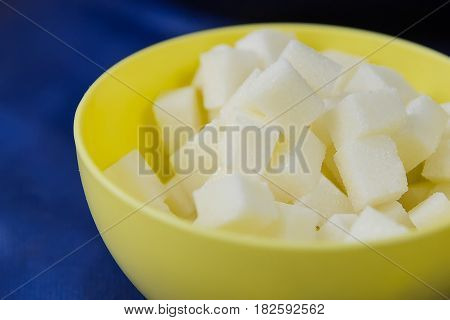 Sugar Refined Cubes In A Yellow Plate