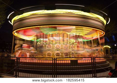 merry go round carousel in motion at night showing colorful lighting and movement