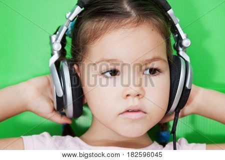 Portrait of mix asian girl with headphones