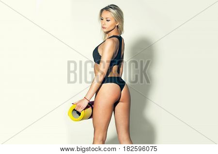 Pretty Sexy Girl Athlete With Sexy Buttocks Holds Yoga Mat