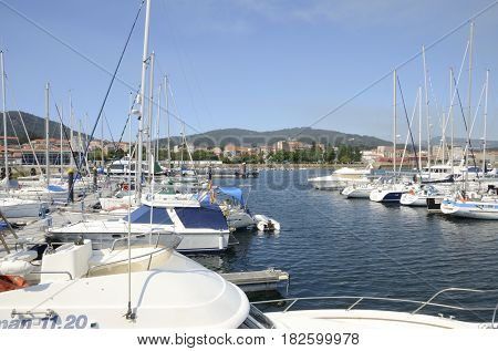 CANGAS DE MORRAZO, SPAIN - AUGUST 9, 2016: Ships in the marina of Cangas de Morrazo in Pontevedra Galicia Spain.