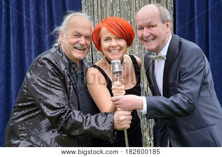 Three Lively Performers Having Fun On Stage