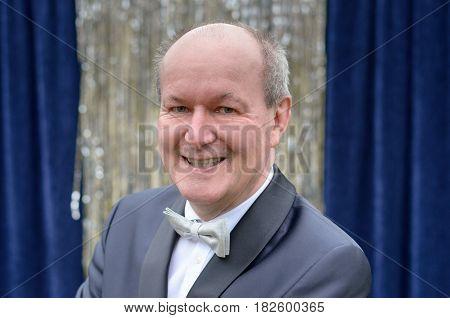 Attractive Senior Balding Man In A Bow Tie
