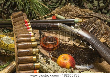 hunting still life with beautiful hunting rifle and equipment