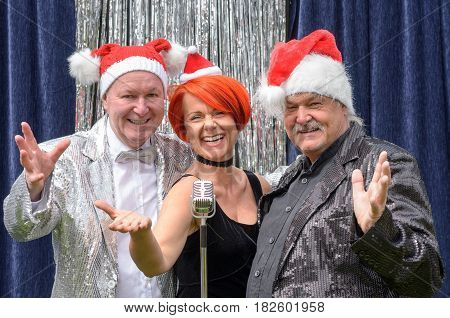 Festive Trio Or Performers Celebrating Christmas