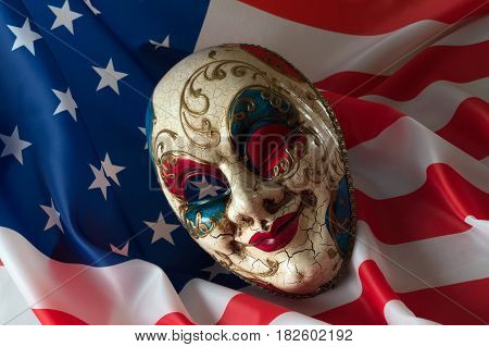 Carnival mask lies on the American flag