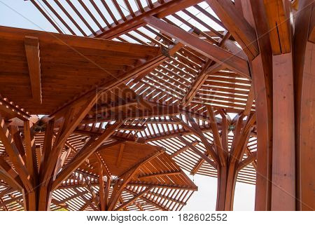Wooden canopy for protection against the sun, through wooden sunshade see the sky
