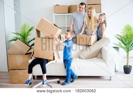 Young family unpacking boxes after they moved into new house