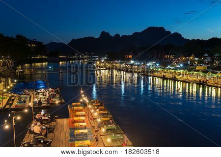Vang Vieng, Laos - January 19, 2017: Restaurant on the riverfront at night in Vang Vieng, Laos