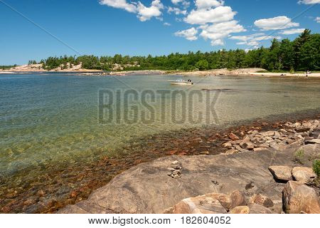 Sunny day on the beach in Killbear Park