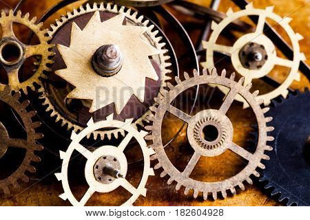 Steampunk vintage cogs gears wheels collection set. Aged clockwork mechanism parts macro view. Different cogwheels teeth shapes objects with textured metal surface. Shallow depth of field photo