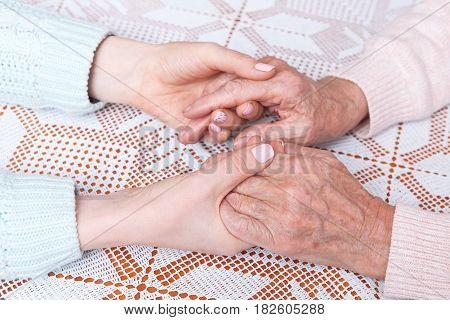 Holding hand closeup. Home care elderly concept.
