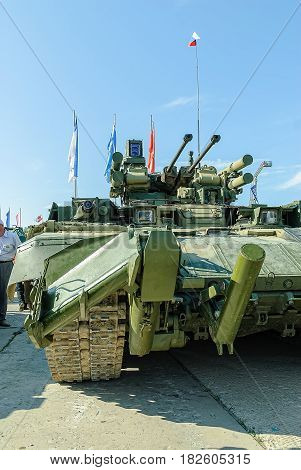 Nizhniy Tagil, Russia - July 12. 2008: Visitors examine military equipment on exhibition range. Tank Support Fighting Vehicle. BMPT Terminator. RAE-2008 exhibition
