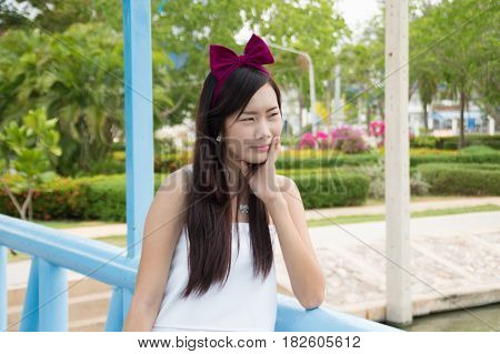 Attractive Young Woman Enjoying Her Time Outside In Public Park
