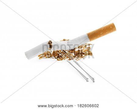 Cigarette with needles and tobacco on white background