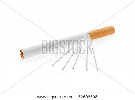 Cigarette with needles on white background