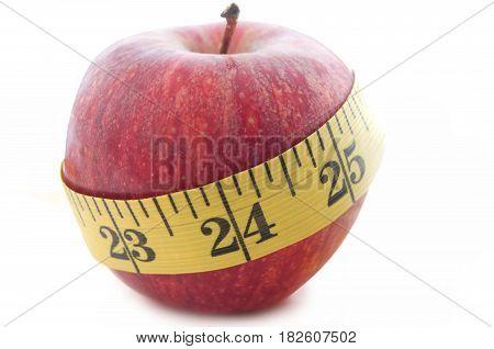 Measuring tape wrapped around an apple closeup