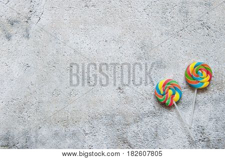 Two lollipops over a shabby chique background