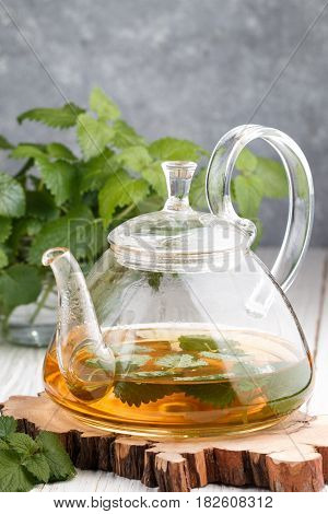 Herbal Tea With Melissa And Mint On The Table In A Transparent Teapot. Selective Focus