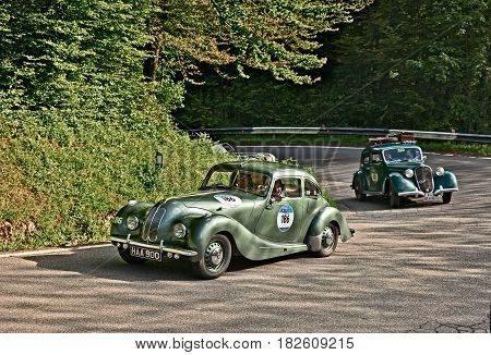 PASSO DELLA FUTA (FI), ITALY - MAY 21: driver and co-driver on a vintage British car Bristol 400 (1949) in historical classic car race Mille Miglia, on May 21, 2016 in Passo della Futa (FI) Italy