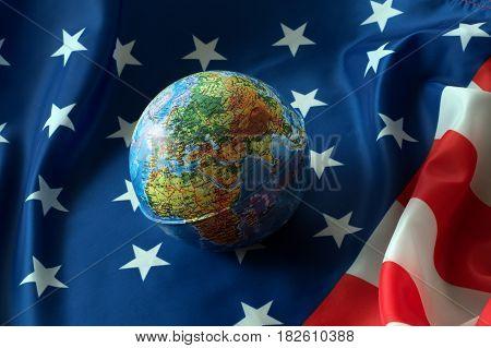 Little globe lying on the American flag