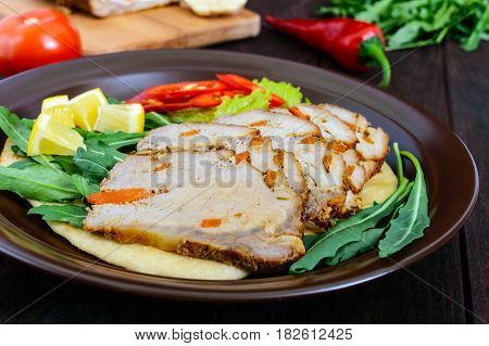 Pork baked ham cutting slices with herbs pepper kapi on tortilla on a ceramic plate on dark wooden background.