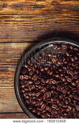 Coffee Beans on Metal Plate. Vertical Orientation and Copy Space.
