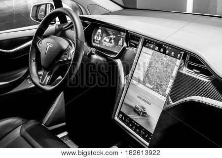 BERLIN - NOVEMBER 09 2016: Showroom. The dashboard of a full-sized all-electric luxury crossover SUV Tesla Model X. Black and white. Produced since 2016.