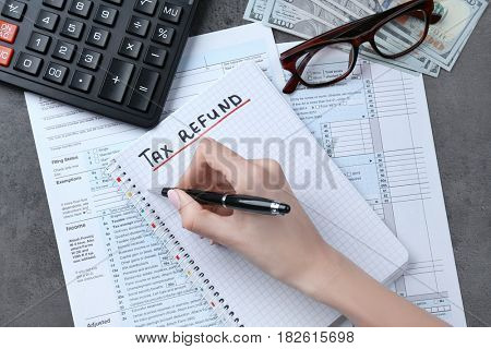 Woman making notes in notebook, closeup