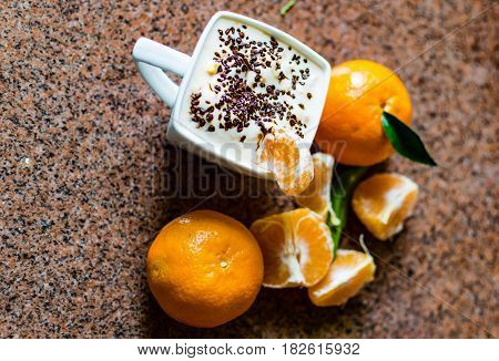 Cup Of Yogurt And Tangerines