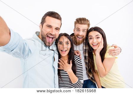 Group Of Excited Friends Making Selfie On The Camera Of Smartphone Showing Great Emotions Of Amazeme